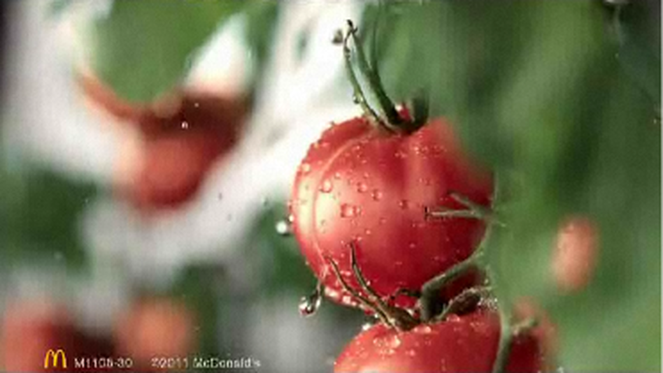Tomatoes getting a splash of water reinforces the notion that McDonald's food is wholesome in China, as seen in this video screengrab. (McDonald's China)