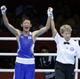 Satoshi Shimizu (left) of Japan celebrates his 10-9 points decision over Isaac Dogboe of Ghana, in their Round of 32 bantamweight bout at the 2012 London Olympic Games. The first full day of competition brought many close finishes in London.