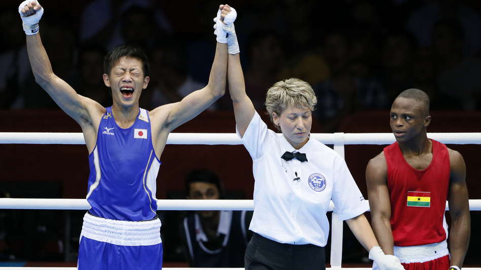 Satoshi Shimizu (left) of Japan celebrates his 10-9 points decision over Isaac Dogboe of Ghana, in their Round of 32 bantamweight bout at the 2012 London Olympic Games. The first full day of competition brought many close finishes in London. (AFP/Getty Images)