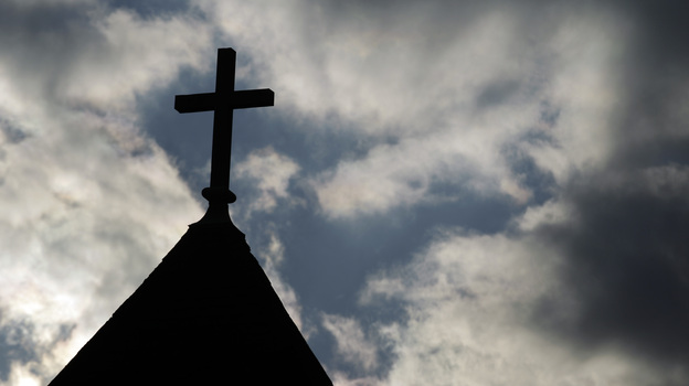 """The cross on the steeple of St. Francis Xavier Catholic Church in Henryville, Ind. A recent Gallup poll says only 44 percent of Americans have """"great confidence"""" in organized religion. (AP)"""