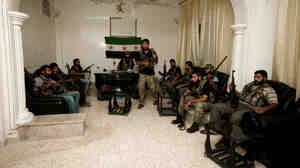 Free Syrian Army fighters are seen in the Syrian town of Azaz, some 20 miles north of Aleppo, on Tuesday.