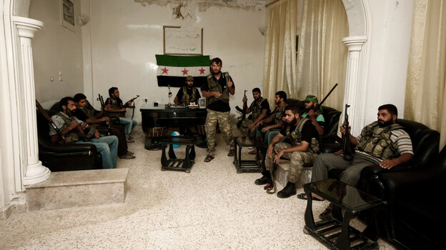 Free Syrian Army fighters are seen in the Syrian town of Azaz, some 20 miles north of Aleppo, on Tuesda