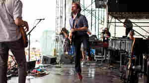 Dawes performs on the Fort Stage at the Newport Folk Festival.