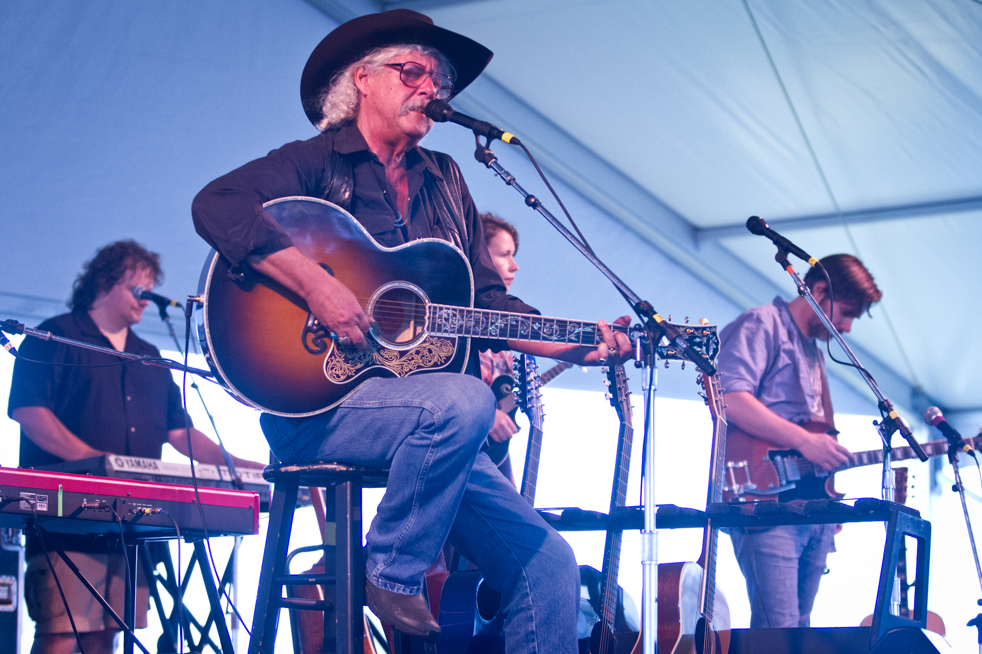 Arlo Guthrie plays with The Guthrie Family Reunion at the Newport Folk Festival moments before being surrounded by his grandchildren on stage.