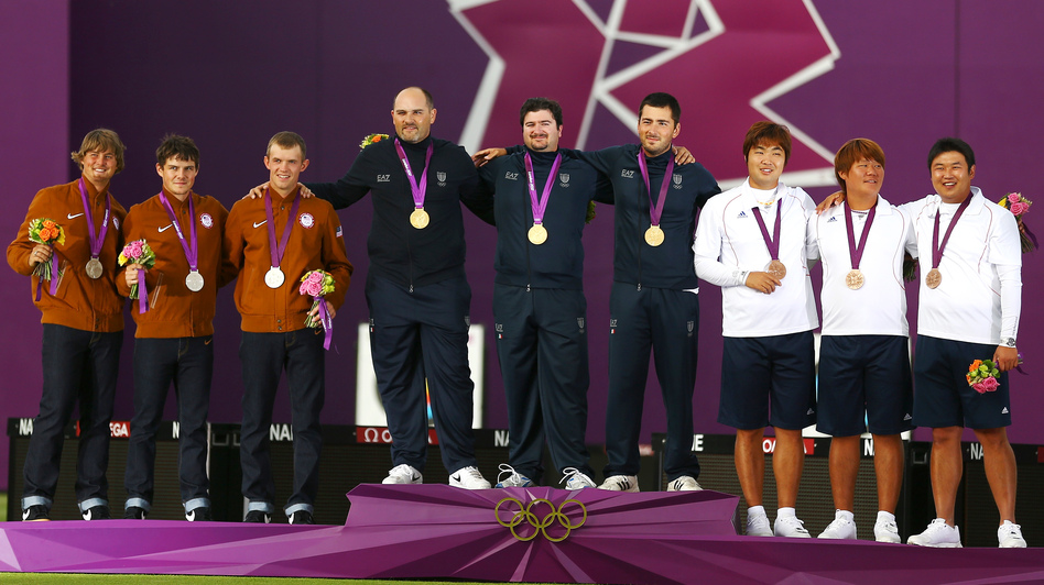 Silver medalists Brady Ellison, Jake Kaminski and Jacob Wukie of the United States, gold medalists Michele Frangilli, Marco Galiazzo and Mauro Nespoli of Italy, and bronze medalists Kim Bub-min, Im Dong-hyun and Oh Jin-hyek of South Korea stand with their medals after the men's team archery event.