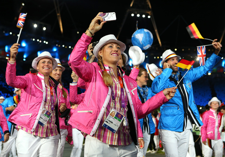 Members of the German Olympic team parade through the Olympic stadium in London during the opening ceremony on Friday.  (Getty Images)