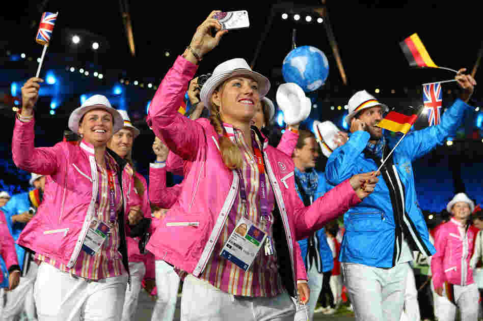 Members of the German Olympic team parade through the Olympic stadium in London during the opening ceremony on Friday.