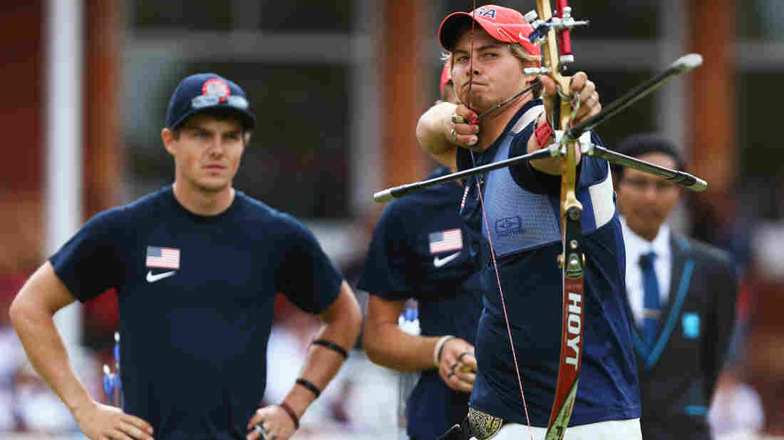 U.S. archer Brady Ellison fires the winning arrow in the men's team archery semifinal Saturday. Ellison and his teammates won the silver, falling just short against Italy in the final.