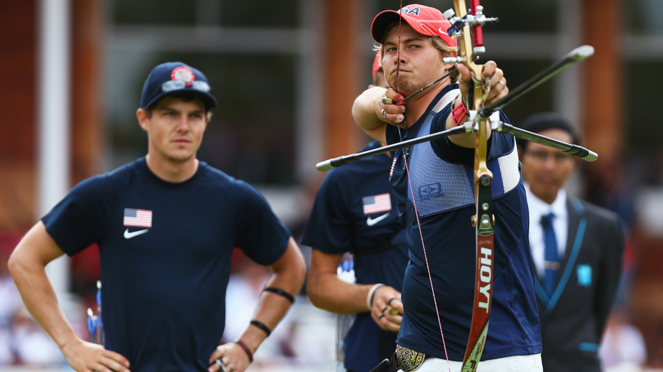 U.S. archer Brady Ellison fires the winning arrow in the men's team archery semifinal Saturday. Ellison and his teammates won the silver, falling just short against Italy in the final. (Getty Images)