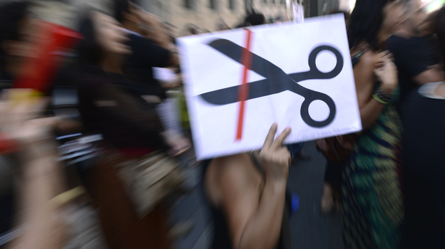 Government employees demonstrate against the Spanish government's austerity measures in Madrid, on Friday. The economic situation has forced some Spaniards to leave the country for work. (AFP/Getty Images)