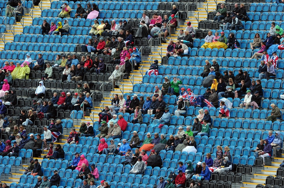 Empty seats and spectators are pictured during the dressage event of the eventing competition at the London 2012 Olympic Games in Greenwich Park, London on Sunday.