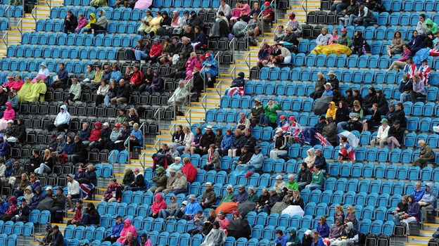 Empty seats and spectators are pictured during the dressage event of the eventing competition at the London 2012 Olympic Games in Greenwich Park, London on Sunday. (AFP/Getty Images)