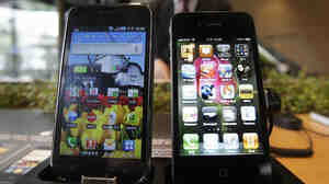 Samsung Electronics' Galaxy S (left) and Apple's iPhone 4 are displayed at the headquarters of South Korean mobile carrier KT. Apple claims some of Samsung's designs violate its patents.