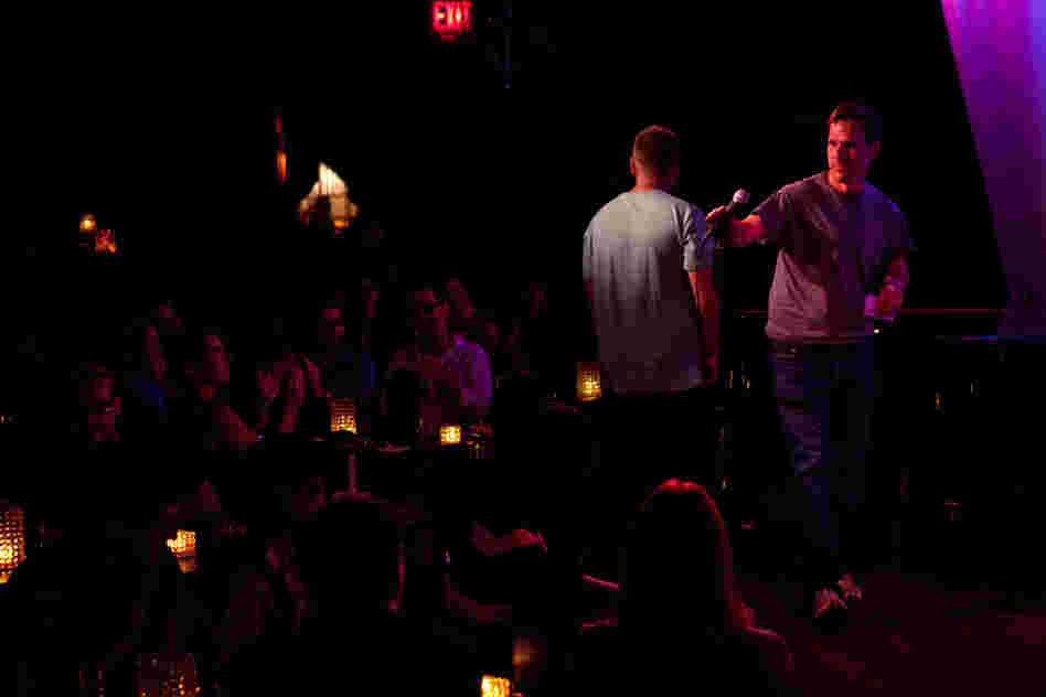 Amateur comedian Robert Lynch takes the mic at the Metropolitan Room in New York City on July 21. Lynch is also an evolutionary anthropologist who is studying what laughter reveals about us.