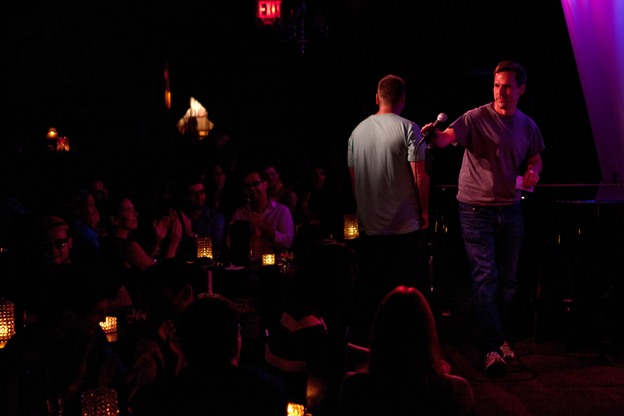Amateur comedian Robert Lynch takes the mic at the Metropolitan Room in New York City on July 21. Lynch is also an evolutionary anthropologist who is studying what laughter reveals about us. (Melanie Burford for NPR)
