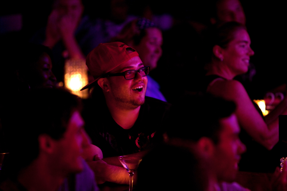 Bruno Fava laughs at a joke at the Metropolitan Room. Lynch finds there's a connection between self-deception and laughter. (NPR)