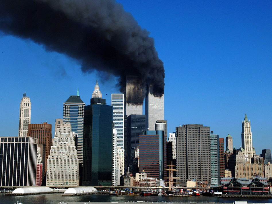 The twin towers of the World Trade Center billow smoke after hijacked airliners crashed into them early 11 September, 2001.