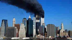 The twin towers of the World Trade Center billow smoke after hijacked airliners crashed into them early 11 Septem