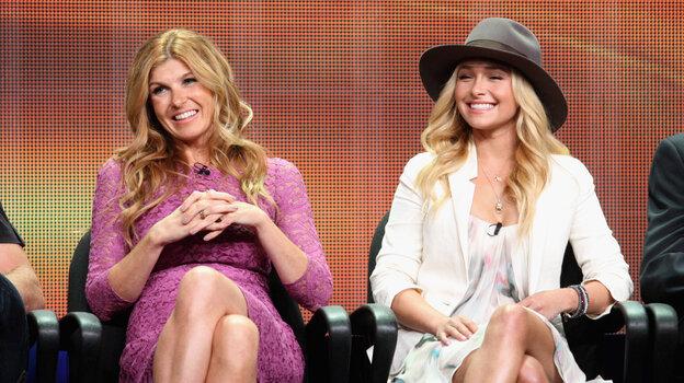 """Connie Britton and Hayden Panettiere speak onstage at the """"Nashville"""" panel."""
