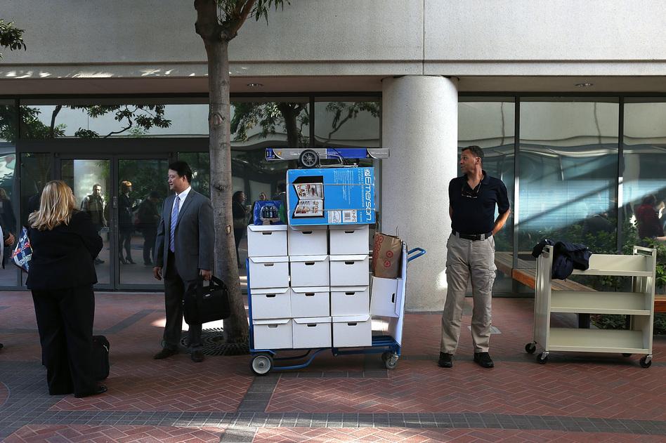 Samsung Electronics Co. representatives wait to enter the Robert F. Peckham Federal Courthouse in San Jose, California on Monday.