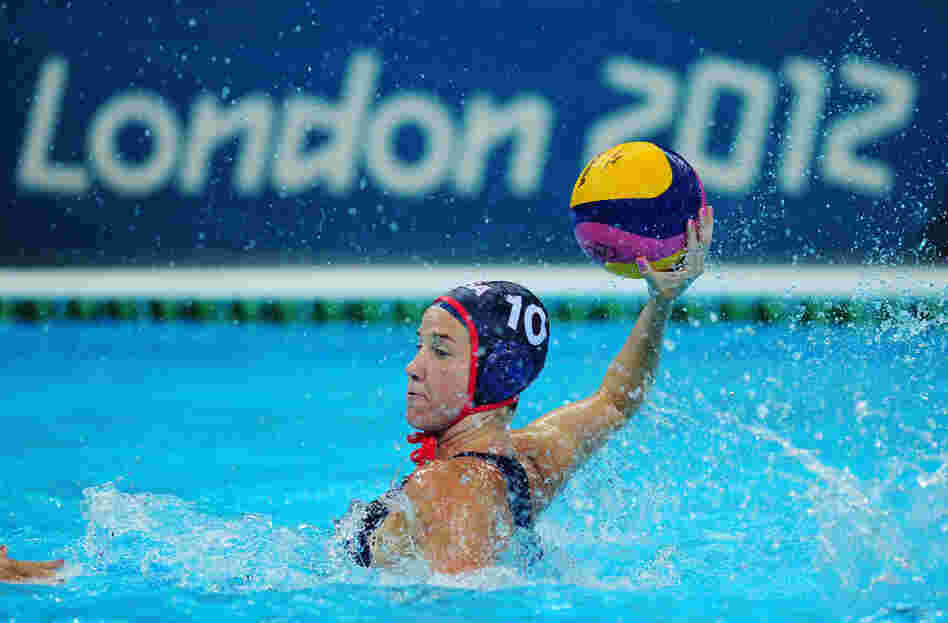 Kelly Rulon of the United States looks for a pass during the women's water polo preliminary match against Hungary. The U.S. won the match.