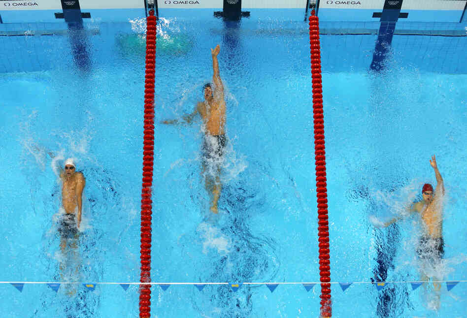 U.S. swimmer Matt Grevers (center) won the men's 100m backstroke final.
