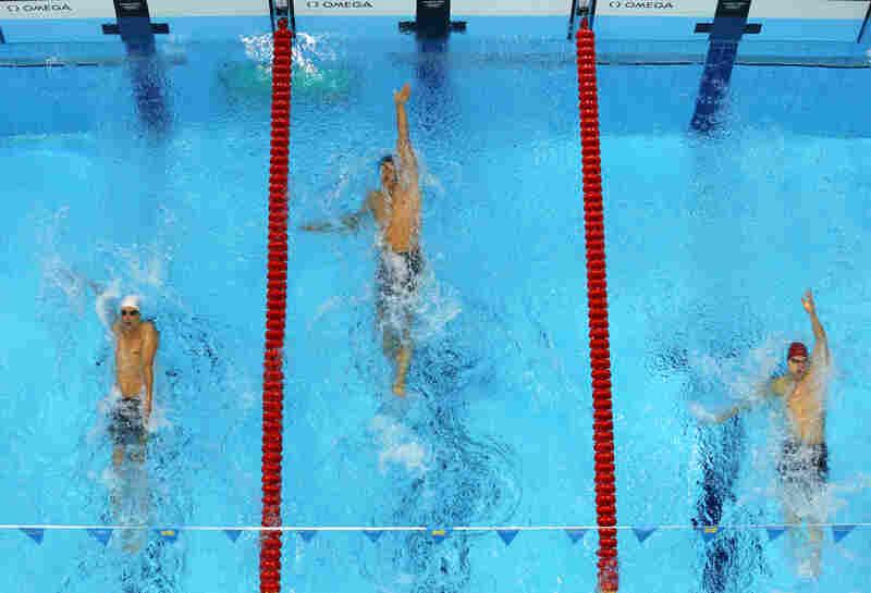 U.S. swimmer Matt Grevers (center) won the men's 100m backstroke final.
