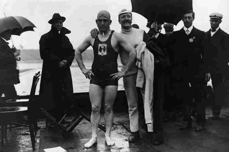 British swimmer Henry Taylor, who won a 400 meter race, with his trainer.