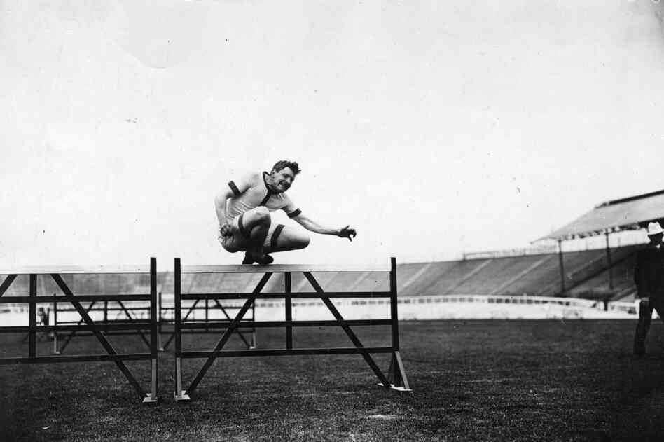 Eric Hussey of Great Britain training for hurdles.