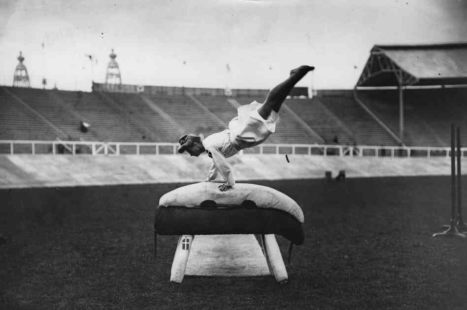 July 1908: A Danish gymnast performing on a gymnastic pommel horse at the 1908 London Olympics. (Photo by Topical Press Agency/Getty Images)