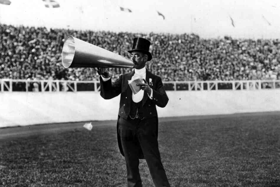 The master of ceremonies using a megaphone.
