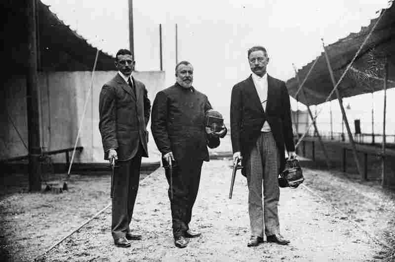 Members of the British fencing team with dueling pistols, which had been an event in 1906. Sir Cosmo Duff Gordon (right) would, a few years later, survive the sinking of the Titanic.
