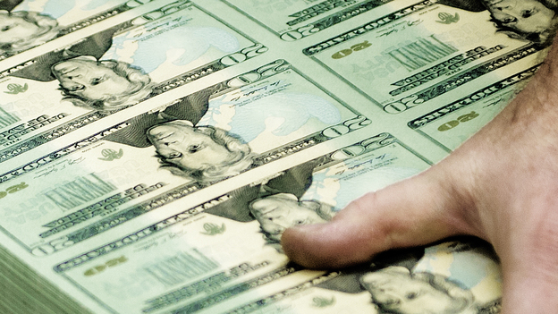 The Fed doesn't literally print money, but it can create more if it wants to try to spur the economy. (AFP/Getty Images)