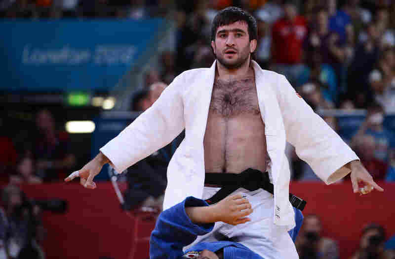 Russia's Mansur Isaev reacts after defeating Riki Nakaya of Japan during the men's 73kg judo finals.