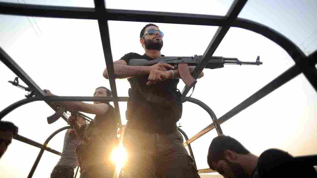 Syrian rebels patrol the streets near Aleppo, Syria.