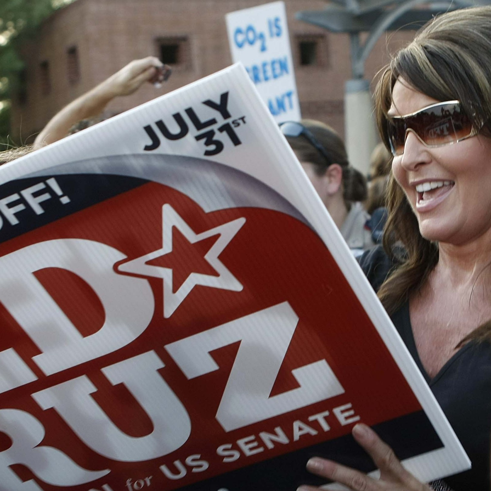 After speaking in support of Texas Senate GOP candidate Ted Cruz, Sarah Palin signed autographs at a rally on July 27 in The Woodlands, Texas.