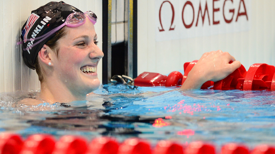 Record setter: U.S. swimmer Missy Franklin celebrates winning the women's 100m backstroke final at the London 2012 Olympic Games. (AFP/Getty Images)