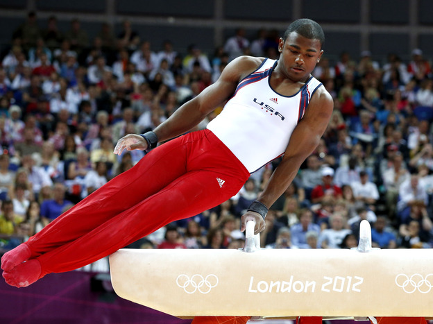 U.S. gymnast John Orozco runs through his pommel horse routine, in the Olympic men's team final at the 02 North Greenwich Arena in London. The Americans fell short of the promise they established in qualifying rounds.