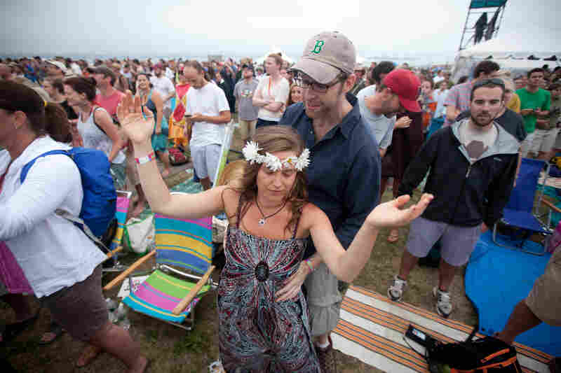 Marinda Snow and Brian Geraghty, both of Cambridge, Mass., get all flower child at My Morning Jacket.