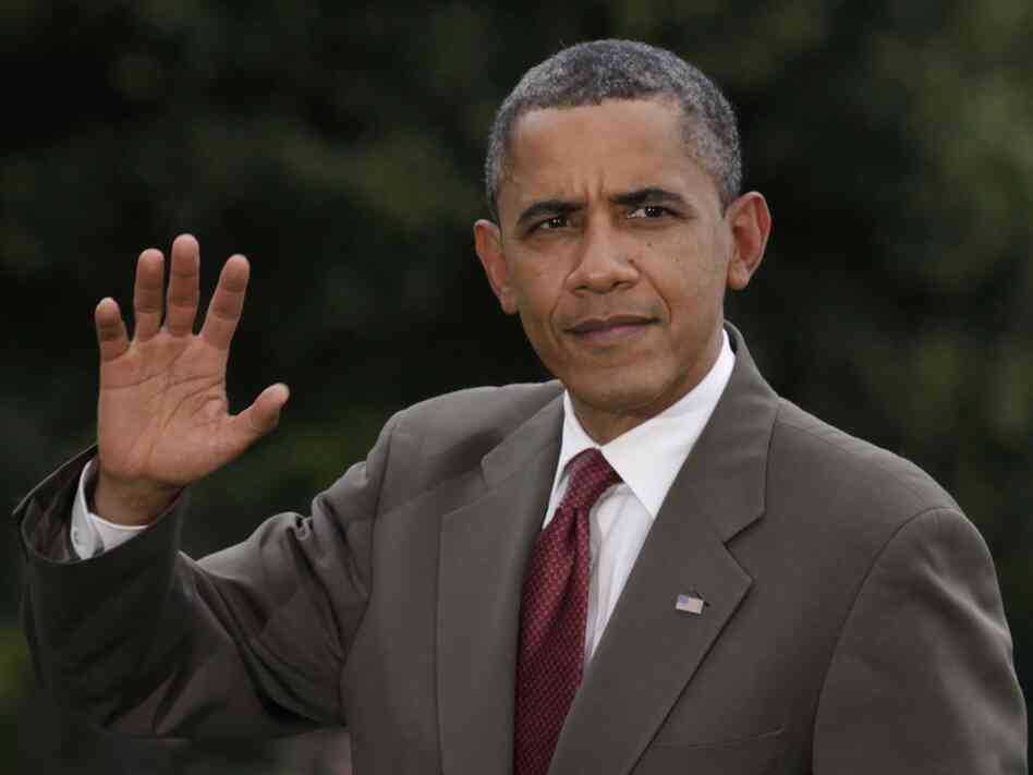 President Barack Obama waves as he walks on the South Lawn of the White House upon his return to Washington, D.C. after attending campaign events in McLean, Va. on June 27.