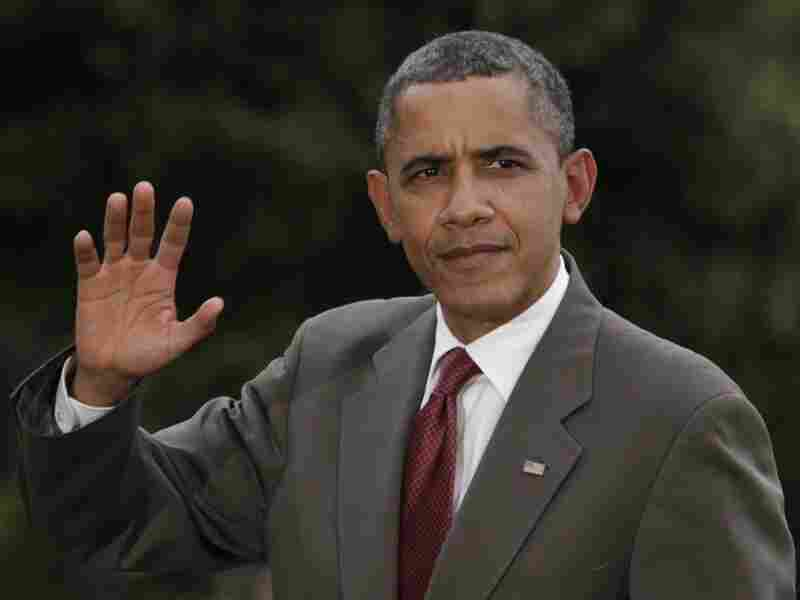 President Barack Obama waves as he walks on the South Lawn of the White House