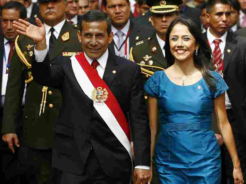 Peruvian President Ollanta Humala gestures next to First Lady Nadine Heredia during celebrations for the 191st independence anniversary in Lima on July 28.
