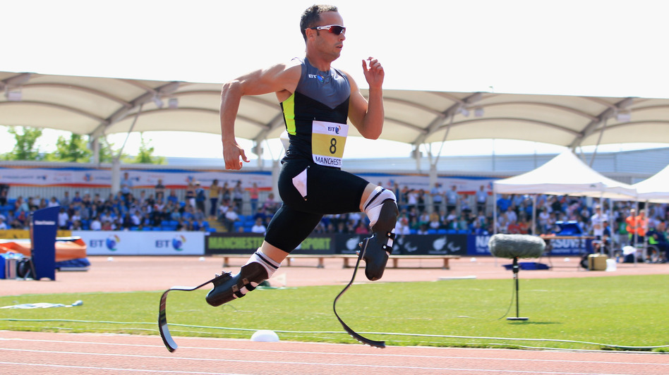 "Oscar Pistorius of South Africa runs in the men's 200-meter event at the Paralympic World Cup in May. Some observers have suggested Pistorius receives an unfair advantage from his carbon-fiber ""blade"" legs. (Getty Images)"
