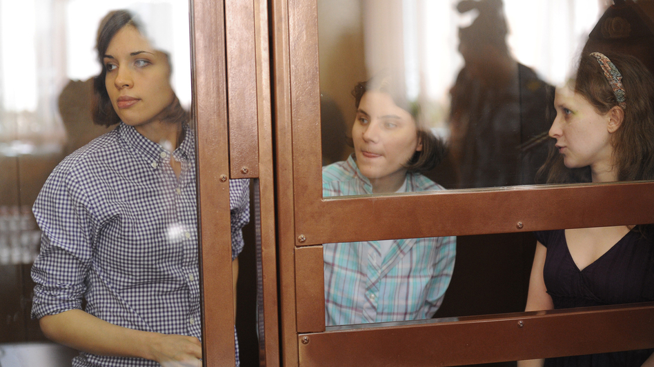 Members of the feminist punk band Pussy Riot, Nadezha Tolokonnikova (left), Yekaterina Samutsevich (center) and Maria Alyokhina, at a hearing in Moscow court on Monday. (Getty Images)