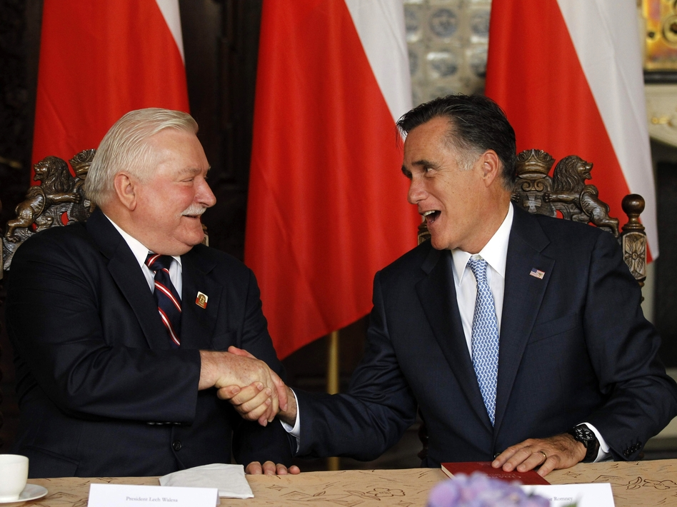 Mitt Romney, right, meets Monday with former Polish President Lech Walesa in Gdansk. (AP)