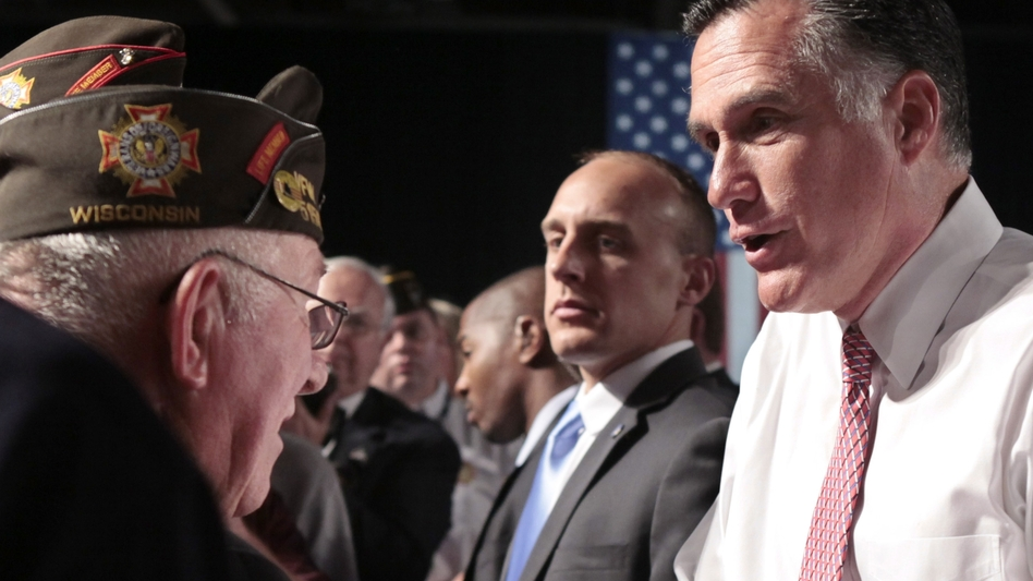 Republican presidential candidate Mitt Romney meets with members of the Veterans of Foreign Wars after his speech at the VFW National Convention in Reno, Nev., on July 24. (AP)