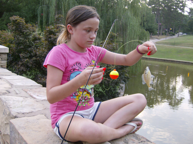 Ciarra Carella, 11, caught at least two small fish on her first visit to the pond.