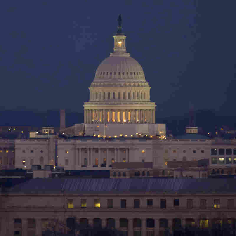 WASHINGTON, DC - FEBRUARY 7: In this handout photo provided by NASA, a full Moon lights the sky above the U.S. Capitol early in the evening on February 7, 2012 from Arlington National Cemetery in Washington, DC. Tonight's moon marks the peak of its waxing.