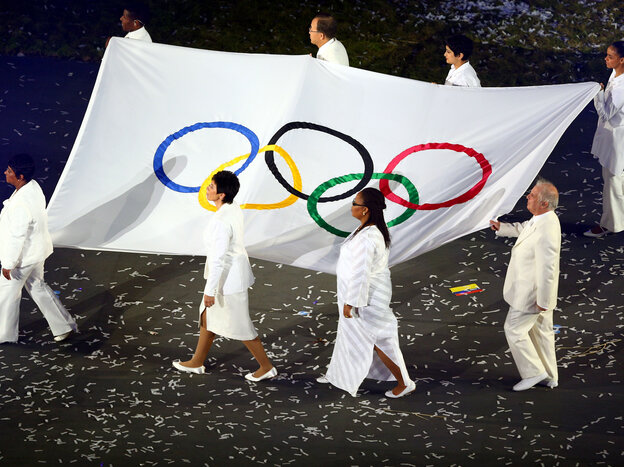 Conductor Daniel Barenboim (lower right) was one of eight notables chosen to carry the Olympic flag at the July 27 opening ceremony of the London Games.