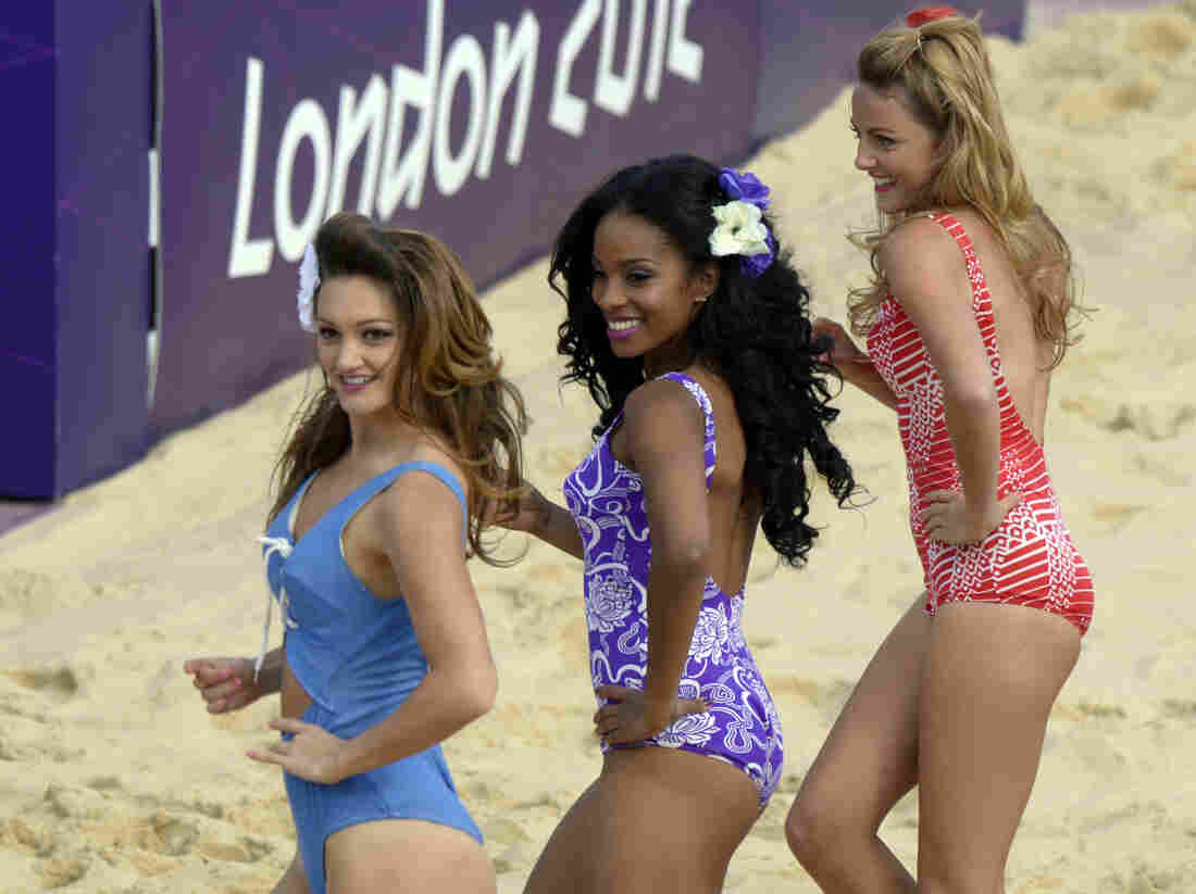 Cheerleaders perform during the women's beach volleyball preliminary phase Pool B match on the Centre Court Stadium at Horse Guards Parade in London on Monday.